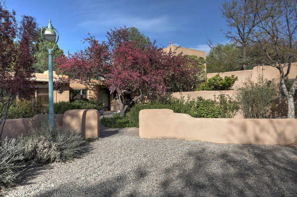 OPEN 4/21* Quintessential North Valley * Drive Down a Shady Lane and Into a Lush, Private Compound with a Main House with 5+ Brs(4600+/-) and A Casita (2 BRS) and a Garage Apt (1BR) * Dual Master Bedrooms, One Down with Large Sitting Area * Other is the Only Room Up Stairs/Fabulous Windows and Light & Spacious Sitting Area and Wood Floors * Sun Room off Kitchen * Vigas * Brick Floors * Storage Galore * Gorgeous Grounds w/pond * Casita is approx 1150 Sq Ft w/2 Bedrooms, Fireplace and Kitchenette ** Apt is Studio Attached to Garage and is Approx 460 sf * 2 Car Garage/2 Car Carport * Active Bed and Breakfast Business,''Adobe and Roses B&B'', Three Units Plus Caretaker Apt, All Zoning Approved, Check 60+Reviews in Trip Advisor * Very Flexible Floor Plan * Oozes Charm and Character * See LO/SO