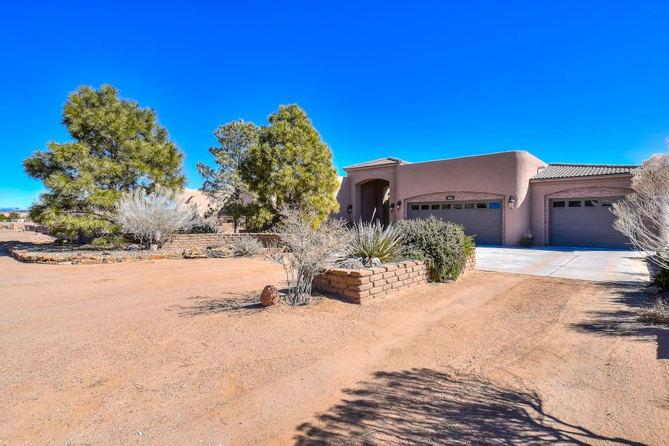 Exceptional finishes, spectacular views & quiet privacy await you in this magnificent custom 1 story contemporary pueblo home in desirable Vista Entrada. No expense spared on finishes. Secured courtyard entry leads to massive foyer w/ custom tile throughout. Open floorplan w/ huge cooks kitchen. Granite counter tops w/farm sink & island, custom cabinets w/ upgraded stainless appliance package.  Split plan w/ owners suite separate from guest bedrooms.  Luxe owners suite w/ fireplace, patio access w/ mountain views, & lavish bath w/ deep jetted tub & separate snail shower. Generously sized guest bedrooms w/ jack & jill bath. Newly added bonus room for office or gym. Huge laundry w/ access to owners suite. Fully landscaped lot w/ great views & mature trees & vegetation.  Newer 60 mil TPO roof