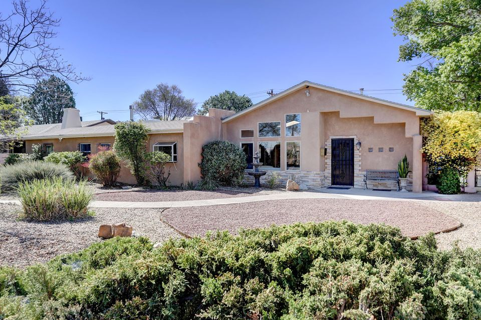 A fantastic home in the Parkland Hills subdivision of Southeast Heights! This beautiful home has many features that you will love.  It has a contemporary kitchen with granite countertops, glass tile, and modern cabinets plenty of kitchen storage; two pull out pantries, three lazy-susans with all stainless steel appliances. The kitchen also has a wet bar and coffee bar with glass lit cabinets with a beautiful garden window. There is a Solid Hickory Parquet Floor throughout the whole house. Dining room has a relaxed ambiance with a vigas fireplace, original brick wall, and built in buffet cabinets. The interior doors are solid wood and the windows are double-paned glass. There is a beautiful French door from the living area leading to the patio outside.