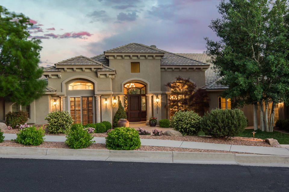 Timeless design and elegant finishes define the most sought after home in the gated community of Sauvignon backing the Tanoan Golf Course. Beautiful views of the golf course and Sandia mountains can be enjoyed from the interior and outdoor living spaces of this classically appointed custom homebuilder's personal residence. Incredible detailing such as coffered ceilings, cast stone fireplaces and columns, arched windows, furniture grade cabinetry, rich granite, and high end appliances define this lovely home. Very functional floor plan includes all living areas and bedrooms on the main level, and all bedrooms have en-suite baths with walk in closets. Incredible outdoor living includes lush landscaping, a beautiful pool, outdoor kitchen, and views in every direction.