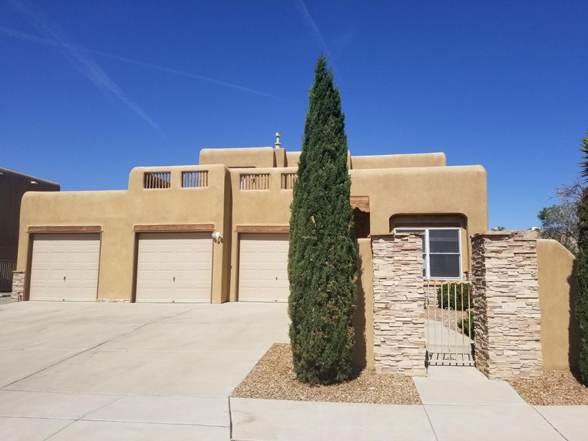 Come take a look at this beautifully spacious pueblo style 2 story home just minutes from Intel in Rio Rancho, NM! High ceilings, natural light and the desirable floor plan make this home irresistable! Did we mention 3 garage bays?! Views, Views, Views. Yes! Come check this one out today!
