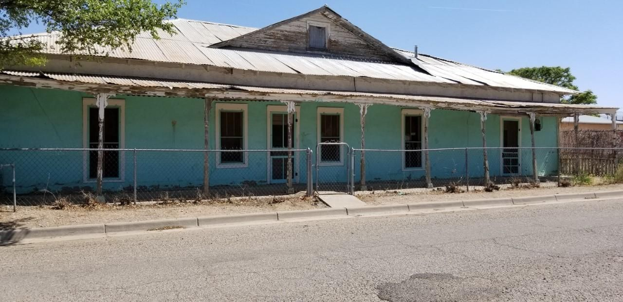 Adobe home sits on .29 Acre Lot in the HEART of BELEN.. Sold as is where is. THIS Home is BOARDED up. NO HEAT OR COOLING OR APPLIANCES. *CASH SALE ONLY!*