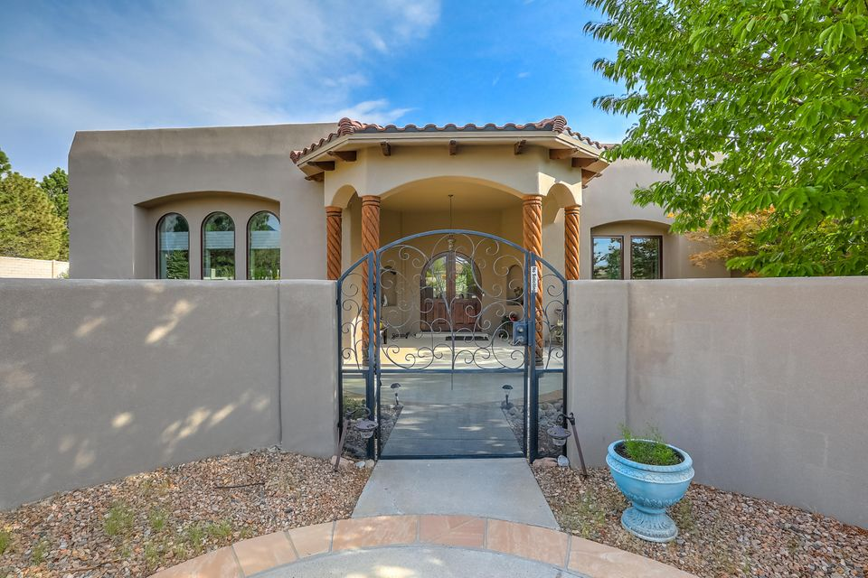 Stunning Custom Panorama single story hm with a 4 1/2 CG w/enclosed car bin on a private beautiful landscaped lot. High ceilings, wood floors, custom tile work, handmade wood doors w/hand forged iron hardware, shelter wood windows, arched doorways, 5'' custom baseboard, tankless water heater, lighted niches, built-in vacuum system & more! Great room boast 14' ceilings w/extra wide crown molding, double arched entry & custom FP. FDR w/custom lighting & cut out for hutch. Gourmet kitchen w/granite ctp & 8 x 6 island, custom skylight w/aged copper effect, natural cherry custom 42'' cabinets w/pull outs plus butlers pantry and built in desk area. MBR suite has attached sitting rm w/built-in plus coffee/wet bar & gas log FP. Enjoy the backyard oasis w/covered patio areas and quiet gardens.