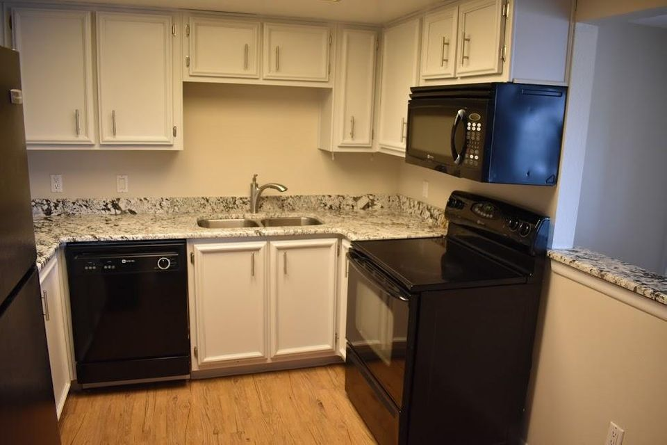 One of the best condos in the Fairways with updated kitchen and bathrooms!! This 2 Bedroom condo is on the ground floor and backs to open space for extra privacy...Features include:**Updated kitchen with granite countertops**Spacious open floorplan**Modern lighting with some track lighting**Custom walk in master shower with goregous tile work**Updated secondary bathroom with tub/shower combo**Beautiful waterproof vinyl plank floors with new carpet in bedroom**Refrigerated air conditioning**Stacked washer/dryer**Full enclosed ground floor patio**Community includes lots of green space and an inviting community pool**This condo is one of a kind and ready for a new owner!!