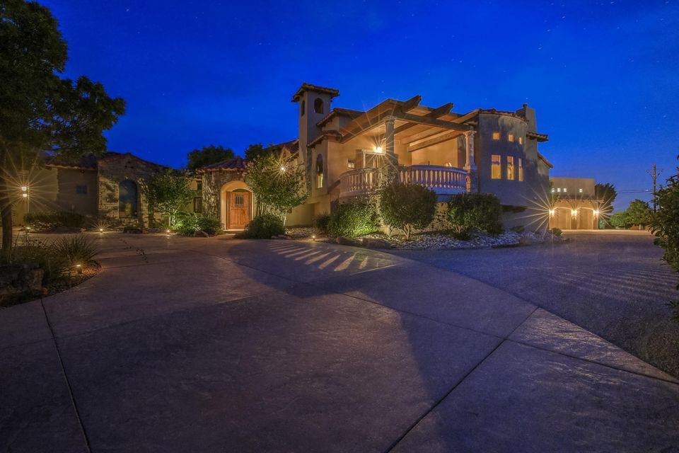 This ''One if a Kind'' Masterpiece located in an Exclusive North Albuquerque Acres gated community is ready for new ownership. As you enter the private entry of this home you immediately feel the love the owners have for this home. With over 7,200sqft 5-6 bedrooms/7 Bathrooms/Great Room/Game Room/Movie Theater/Formal Living Room/Office/Pool House with Steam Shower /Detached One Bedroom Casita (Featuring a Living Room-Kitchen-Bathroom-Laundry Room with an attached 2 Car Garage) Multiple View Decks/Covered Patio with Outdoor Kitchen/Covered and Heated Swimming Pool/an Attached 3-4 Car Garage with an Indoor Basket Ball Court/ Cathedral Ceilings/Custom Doors/''Spa Like'' Master Bath/Walk in Closets/ AMAZING MOUNTAIN VIEWS/and so much more I have to show you the rest....