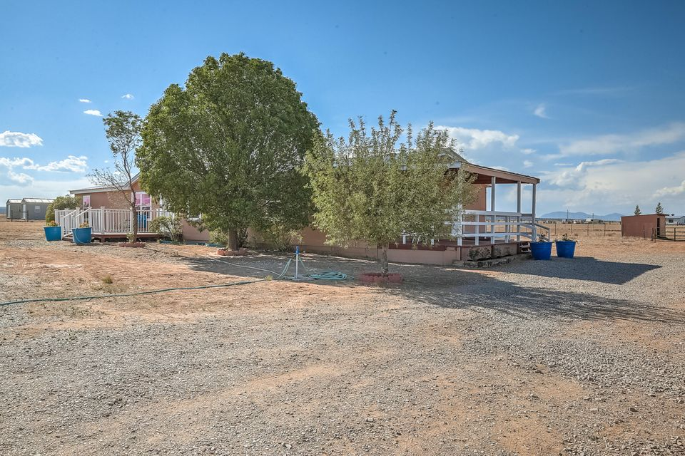 Beautifully updated home on 4 fully fenced, completely usable acres of land! The address is Moriarty but being off Lexco Road it's almost in Edgewood and an easy drive to Albuquerque, Santa Fe, or Estancia.  A huge manufactured home with 4 bedrooms, 2 bathrooms, 2 living areas, and an office / bonus room! Features include new Pro Panel roof, new double pane windows, new paint inside and out. New flooring includes reclaimed pine, hardwood oak, new tile, and new carpet in the bedrooms. All new Pex plumbing, new lights with fans in every room, and a wood stove in the main living area.  The home has 6-inch walls with zone three insulation (the best) making it easy to heat and cool. It's on natural gas and has a 400- foot private well.