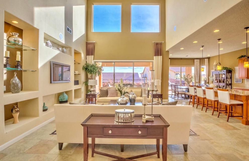 HUGE Price REDUCTION to this stunning New Mexico Green Build Silver Certified Home! Enjoy A Courtyard Entrance with a Fireplace. Soaring Ceilings & A Beautiful Staircase Welcomes you in the Foyer. A Spectacular Kitchen opens to the Family rm & lots of Natural Light. The Executive Kitchen boasts Jenn-Air Appliances, Custom Cabinets, Brfst Nook, Butlers Pantry,Oversized Granite Island & Bar. On the main level Step into an Oasis in the Master Suite, 2 Walk-in Closets, dbl sinks & Separate Vanities. A Separate Office & Laundry rm. Enjoy upstairs with a Separate multipurpose space, Loft & 4 add bdrs. This Amazing Home Features a Tandem Garage, Tank-less hot water heater, Low-E double-pane windows, Fully Landscaped Yard with a Grill, Turf, Deck & lots of charm throughout. Welcome Home
