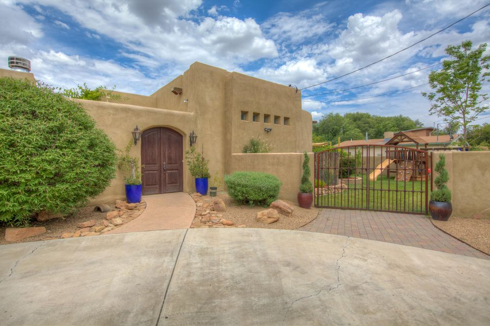 ****Los Ranchos *** one of a kind, built in 2002,home near Rio Grande - enter through inviting courtyard w/fireplace. Beautifully finished 4-5 bedroom home. Large great room w/high ceilings,lots of light views of Sandias & beautiful patio w pool. Granite counters in kitchen,double ovens, large island. Master bdrm has adjoining exercise room or nursery w patio w outdoor shower. Great family room french doors opening onto outdoor patio. Private Guest house/office w/tastefully finished kitchen/bath. This is a gorgeous property with back yard access.