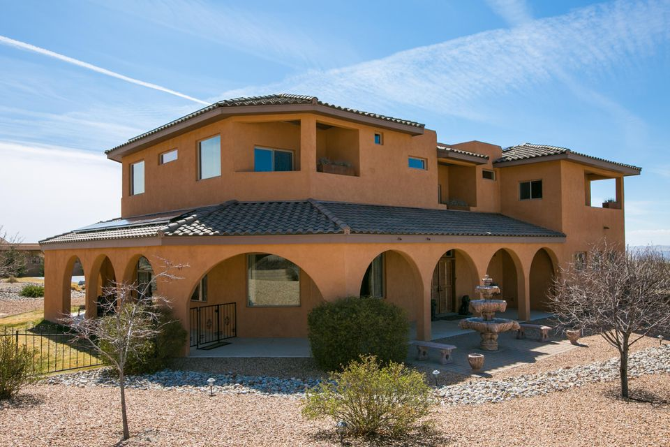 OPEN HOUSE!!! SAT 1/19 FROM 11:00-2:00.WOW check out this New Price!!!North ABQ Acres at its finest. Built in 2007 featuring Archways, Brick accents and Rustic finishes . Stay in one of the 5 well appointed bedrooms with private covered patios. Enjoy sipping your favorite beverage while breathing in the beautiful mountain and city views. Featuring 5 bedrooms 4 bathrooms, Beautiful kitchen with marble counter tops, Custom Kitchen Island, Gorgeous rustic cabinetry, huge walk in pantry, Wine fridge, Sub Zero refrigerator and more. Experience the never ending New Mexico sunrises & sunsets from the wrap around covered patio or from the Open Sun deck on the upper level. Truly an amazing property with .89 acres and basketball court.