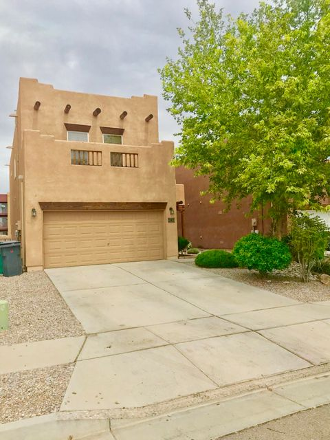 Welcome to this lovely, move-in ready, conveniently located home. The outside of the home has a tasteful southwest appeal with the exposed beams and vigas. The open floor layout downstairs maximizes the usage of space. This home boasts a large and inviting great room, an eye catching kiva style gas fireplace, beautiful bamboo hardwood floors, aesthetically appealing nichos and arches,  low-E windows, tile in the wet areas, a fabulous kitchen bar top for additional seating and/or entertaining, a kitchen island, plenty of counter-space, stainless steel appliances, a wide above range stainless steel hood, gas cook-top, and more. Carpet throughout the loft and all bedrooms and fresh paint. H2O softener, reverse osmosis system, and refrigerator convey. Come make this your home today.