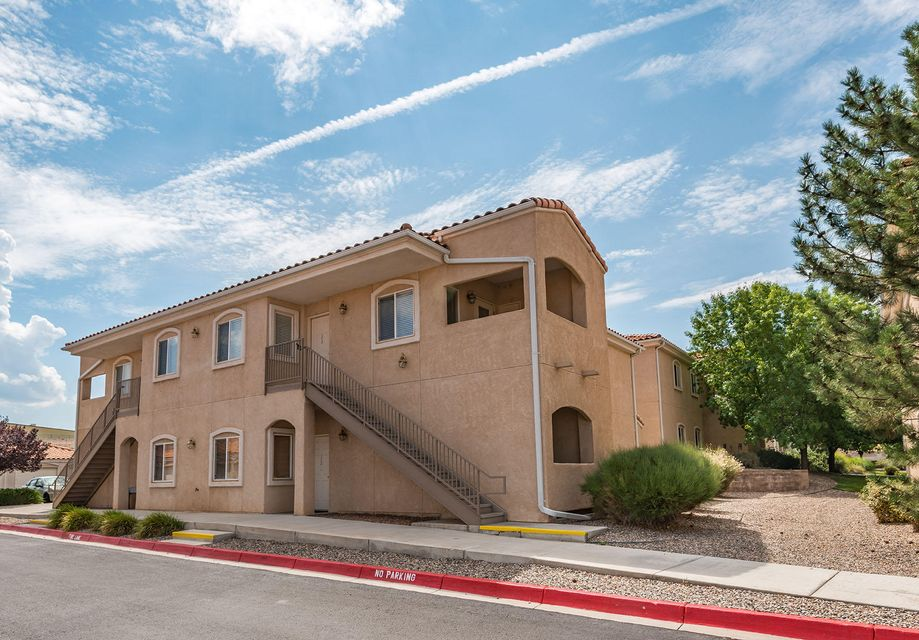Come see this gleaming, light filled, and impeccably maintained 3 bedroom corner unit at Rancho Mirage Condominiums.  Views of the Sandias await you at the top of your own dedicated staircase. The spacious and flowing layout includes 3 bedrooms with ceiling fans and 2 baths, and washer / dryer for convenience.  The open kitchen is great for entertaining or meals at the counter. This lovely apt. is also private - away from main entrance traffic yet very close to the second clubhouse and swimming pool. There's a dedicated parking spot as well as your own garage with convenient shelving. A great value and move- in ready.Vista del Norte Park is right down the road and it's a quick drive to I-25.