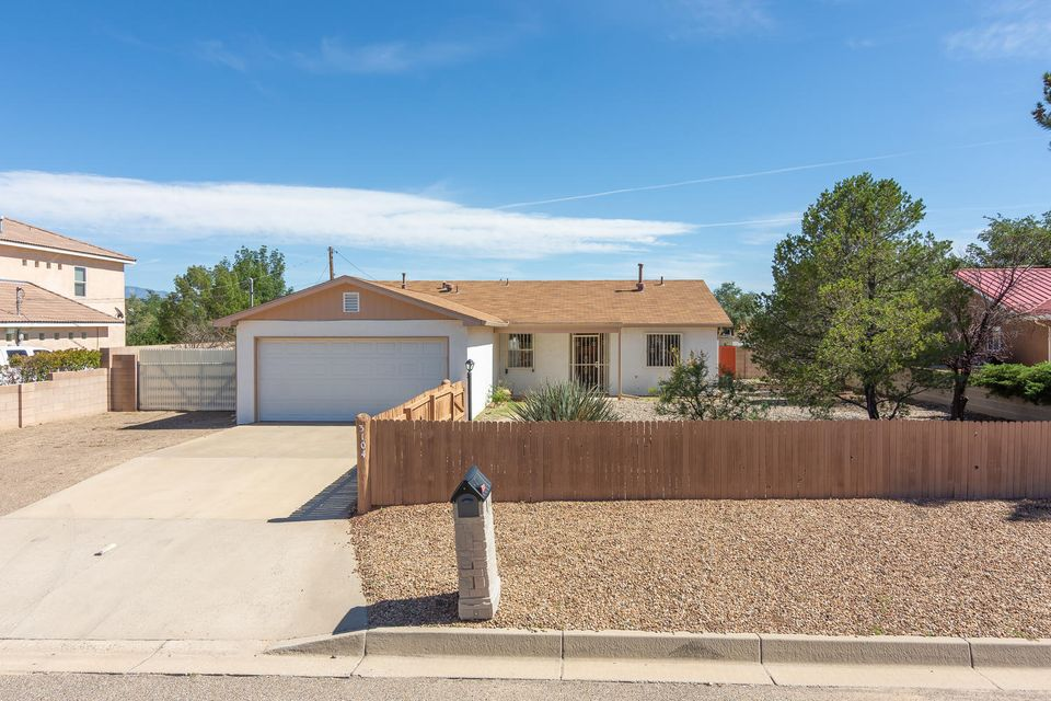 OPEN HOUSE! Wednesday 9/19 from 3 to 6 PM and Friday 9/21 from 3 to 6 PM. Close to restaurants and shopping and situated on a 1/2 acre lot in Rio Rancho Estates, this charming, 3-bedroom home features an open floorplan, private, fenced front yard, spacious master bedroom with en suite bath, sunny family room with back yard access and mountain views. One bedroom has an adjacent study/office/nursery area. Side yard has space for RV parking and back yard has storage shed. A wonderful starter home or a cozy, convenient, comfortable place to retire. Priced right! This one won't last long!