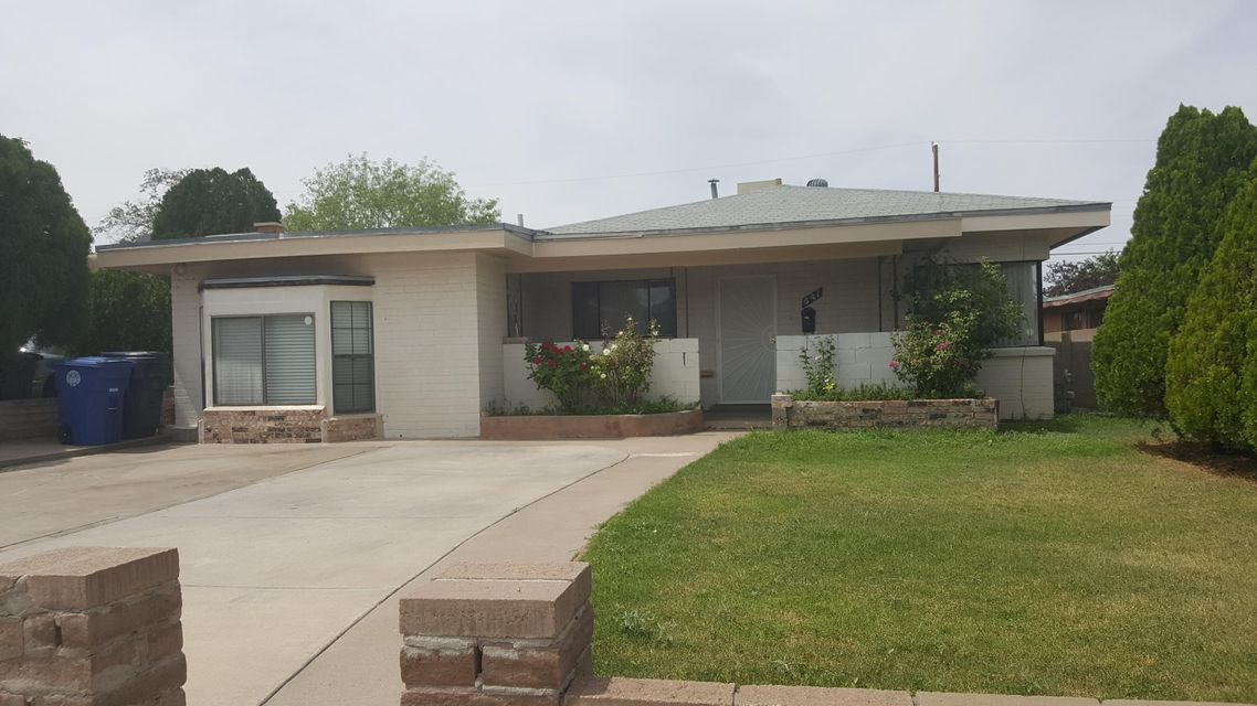 Great property close to the fairgrounds, Casino skate park and I-40. 3 bedroom home with nice landscaping and 2 living rooms.