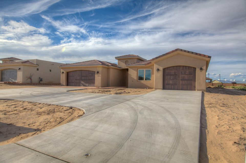 New Construction! Built by Award Winning PS Custom Homes. Don't Wait, this home will sell fast, built in up and coming Neighborhood in Rio Rancho, surrounded by Gorgeous Custom Homes minutes from Albuquerque. Great School District, Close to RUST Medical Hospital, Shopping, Restaurants and Family Entertainment. This Superior Home was Constructed and Designed with Energy Efficiency in Mind. Welcoming Open Floor Plan, Large Bedrooms with Walk-in Closets. Stunning Gourmet Kitchen, with a Huge Baker's Pantry. Exquisite Tasteful Finishes, Class and Sophistication abound... TWO Seperate Garages. One for your guests in the attached Casita and a two car garage on the opposite end!