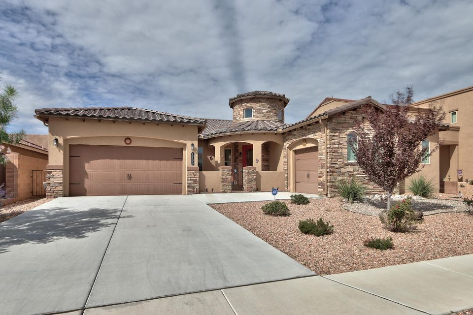 This gorgeous, light-filled 4-bedroom home in family-friendly Cabezon backs up to walking trails & open space. Full of upgrades, including granite counter-tops in kitchen, walk-in pantry, top-of-the-line stainless steel appliances & Italian floor tile. Kitchen opens to beautiful living & dining spaces with lovely engineered hardwood floors. Separate 300-SF finished sun room (not included in square footage) is perfect for enjoying morning coffee or relaxing with a book. Guest suite separate from huge master that features spacious walk-in closet. Beautifully cared for & private home in great school district with access to Cabezon community pool, parks & more. Shows like a gem!