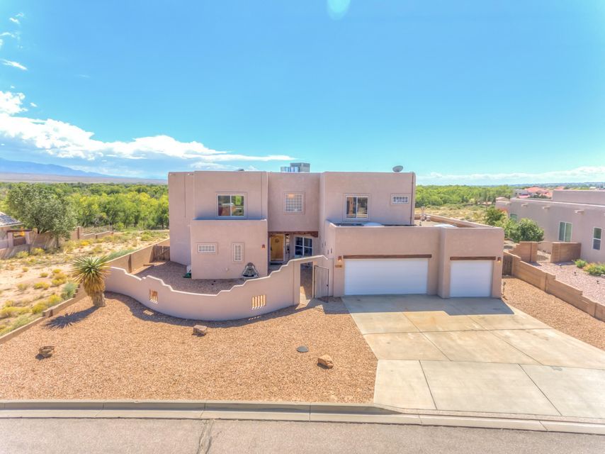 Breathtaking views from this immaculate 3 bedroom 3.5 bathroom home nestled along the bosque in Rio Rancho.  This stunning custom home features a remodeled kitchen, remodeled bathrooms, new downstairs flooring, upgraded light fixtures, and paint just to name a few!  There are two master bedrooms, one on each level.  Large office space could easily be converted to a 4th bedroom.  HUGE upstairs loft area that is perfect for a game room, playroom, homeschooling room, the options are endless!  Exterior features a 3 car over-sized garage, backyard access, outside kitchen area, and full landscaping.  Did we mention the VIEWS?  Location can't be beat, just feet away from nature trails and the Rio Grande river.  Schedule your private showing today!