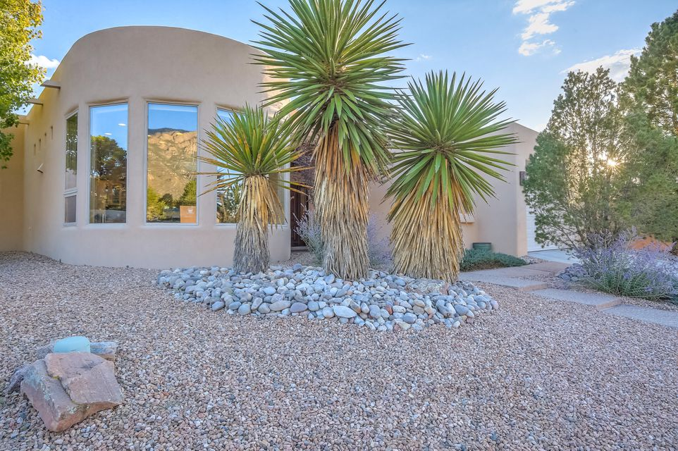 This One of a Kind Custom home has Breathtaking views of the Sandias from the Breakfast Nook! Close to shopping and schools! Passive solar sunroom. Recent updates include Carpet, ThermaTru entry door, Dryvit synthetic stucco, Silicone roof by Roofing USA, KitchenAid kitchen and dry bar refrigerators, HVAC vent covers and smoke detectors, two 12' Mastercool coolers, outside Gazebo, and New landscaping updates!Massive Vigas and Soaring ceilings compliment the sunken Great Room with built in entertainment area. Open and Bright with eleven Skylights and Clarestory windows. Check out the large Gourmet Kitchen with Granite Transformations and open bar stool area, Dry bar in the  Sunroom, Ultra Flush Kohler commodes in hall and master, 2x6 construction, oversized 2 1/2 car garage  and Much More