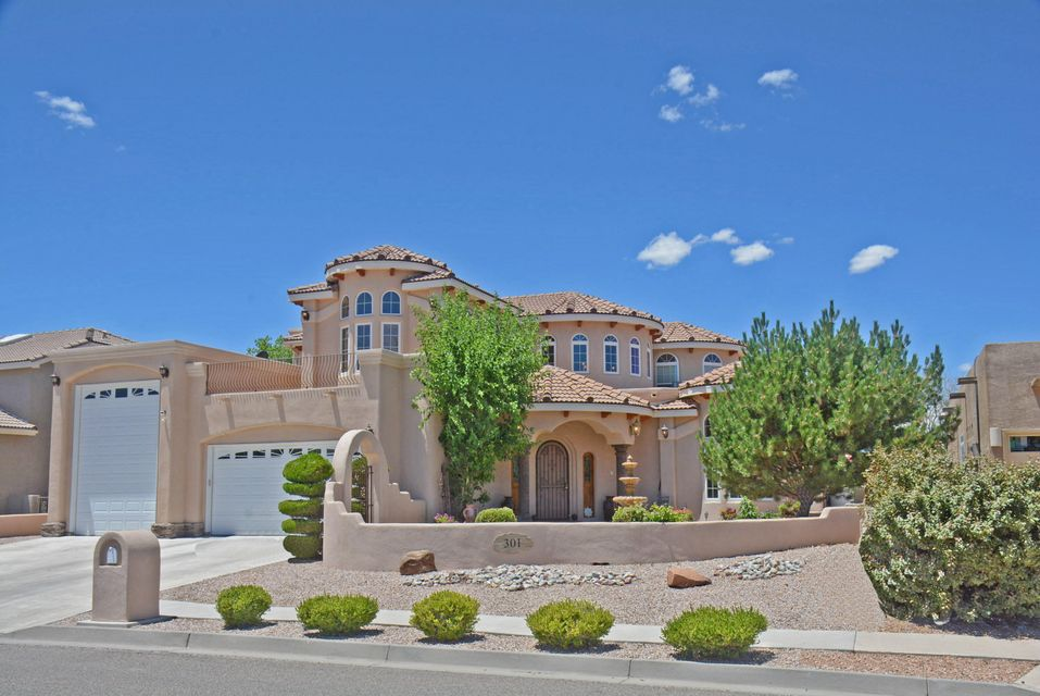 Elegance and charm abound in this fabulous Tuscan designed home. Open floor plan with large greatoom with high beamed ceiling and formal dining room. Gourmet kitchen has custom cut granite countertops, stainless appliances, hickory cabinets breakfast nook and walkin pantry. Large main floor master suite with sitting area and bath with stone sinks, jetted tub and separate shower. Guest bedroom and bath on main floor plus two additional bedrooms, TV room/gameroom/bonus room, loft and bath upstairs. Custom features include designed stone work, carved woodwork and ornate staircase. Spacious courtyard has stone pillars and fountain. Three car garage includes RV garage with 16ft door. Several balconies offer scenic vistas and mountain views. This is one of the finest homes in Rio Rancho.