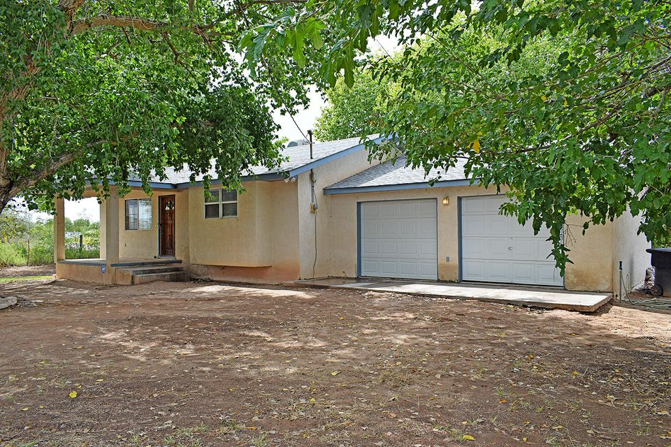 This country living home nestled off of a main road that takes you to the modern conveniences in minutes. Well maintained home on corner lot with 2 irrigated acres several fruit trees on property. Water rights have not been declared on property but may be possible. Home has 2 large bedrooms, breakfast nook and large kitchen. Make an appointment today to see this property with room to grow.