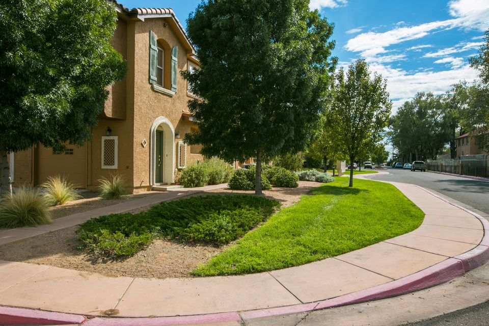 Beautifully maintained condominium in the desirable, gated Villas community. Second floor unit with open floor plan encompassing  living room, dining and kitchen with bar.  Patio allows for bistro table/chairs and mountain view. Warm contemporary paint color palette throughout.  New, upgraded kitchen appliances in stainless/black; cherry-stained cabinetry with large pantry.  Updated custom ceramic tile in kitchen.  Ceiling fans and bronze chandelier in dining.  Over-sized master with room for sitting area.  Master bath includes double sinks, garden tub and shower.  Easy access to downtown, the University and nearby medical complexes.  HOA covers clubhouse, pool, hot-tub, park/play area and manicured grounds.