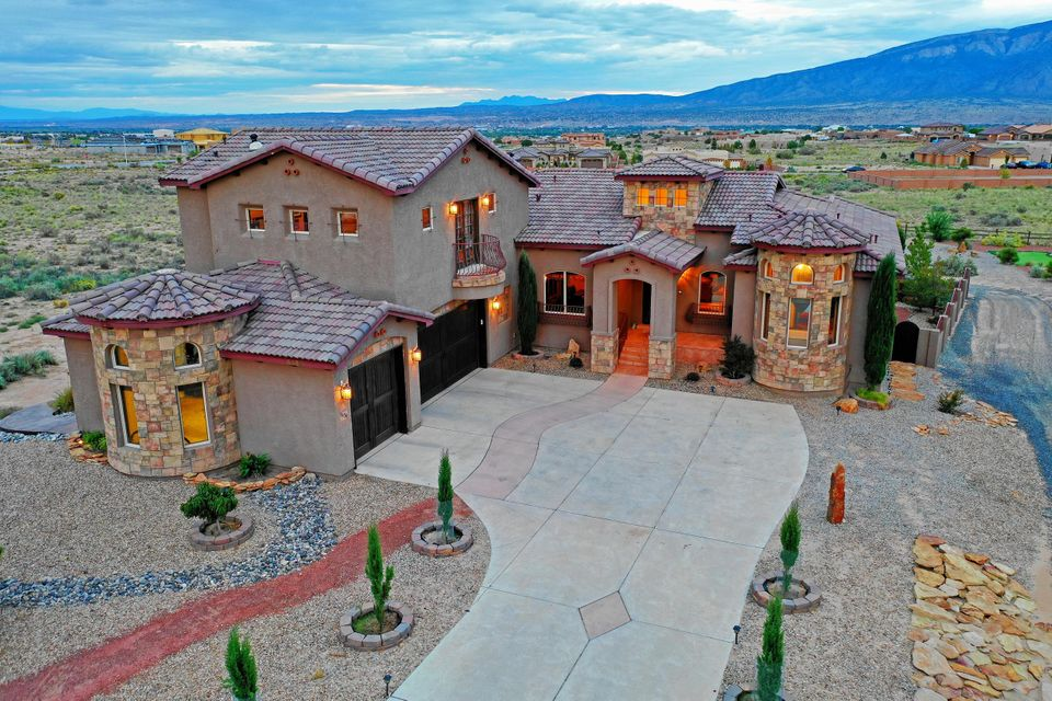THE BEST OF THE BEST! ***Gorgeous Tuscan Inspired Estate* Located In Vista Entrada w/ Paved Roads & City Utilities* This Amazing Home Possesses The Most Exceptional VIEWS of the Sandia Mountains*  A Resort Like Property on .76 Acres, This Residence Is The Perfect Combination of Living & Entertaining* Spectacular Outdoor Spaces w/ Sparkling Gunite Inground Pool, Hot Tub, Oversized Covered Patio Space, Outdoor Kitchen, BB Court & Putting Green!* Amazing Interior Spaces* Over 5300 Square Ft, 2 Living Areas, 5 Bedrooms, 5 Baths, Private Study/Library & Spacious Theatre! Well Equipped Chef Inspired Gourmet Kitchen*Fully Finished Walk Out Basement w/ Fireplace* Close To Shopping & Major Roads*  In The Desirable V Sue Cleveland School District*  Call For Your Private Tour Today! Virtual Tour!!