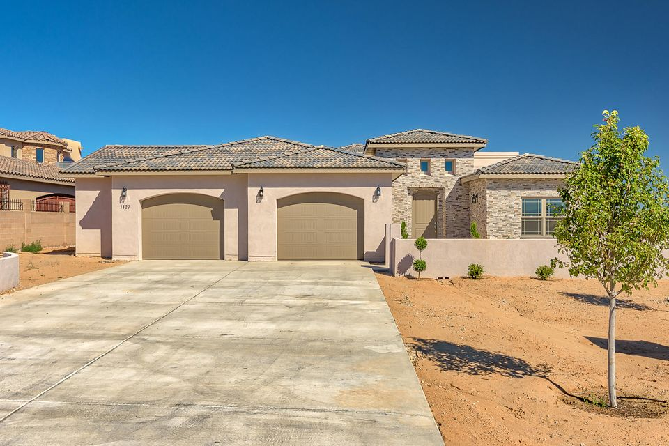 Custom Built Home by Signature Homesfeaturing spacious Great Room which opens to Kitchen and Dining area!Ceramic tile throughout Living Area, Gourmet Kitchen with upgraded cabinets, Island and Pantry.  Master Suite features Separate Tub and Shower, Double Sinks plus Walk-In Closet.  4 Bedrooms plus Flex Room/Study, 4 Bathrooms, oversized 2-Car Finished Garage/Workshop.   Views of Sandias and City of Albuquerque from the View Deck!