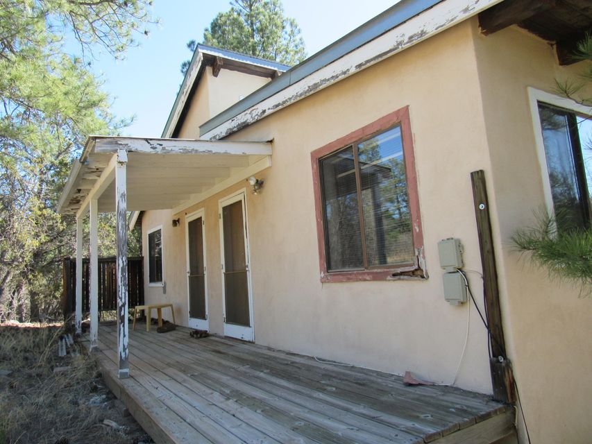 Cabin duplex getaway or rental opportunity! Take in the views at your own mountain retreat surrounded by tall ponderosa pines and native flowers. Borders national forest for activities and privacy! Schedule your showing today!