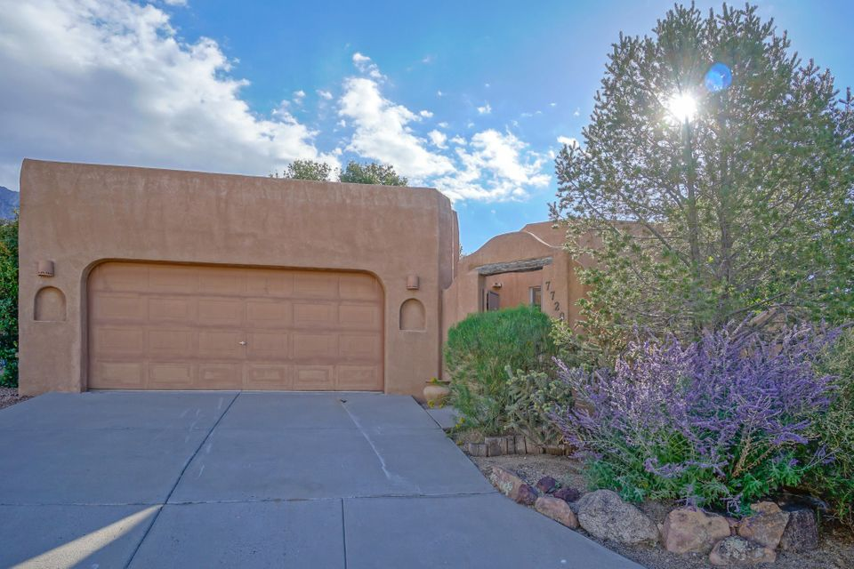 Price just reduced by $10K in Desirable Sandia Heights!  Quiet living in a well cared for, quiet cul-de-sac. Less than a block from W.L. Jackson Park, which may quench your thirst for green grass as YOUR yard is EASY-care, no mowing, with an enclosed front courtyard, and an apple tree in the high-walled private backyard.  BRIGHT home with skylights, large windows, and high viga/wood ceilings.  Two kiva gas fireplaces, one in the master!  You HAVE to come check out the old-style wood cooking stove in this kitchen, along with a wood block prep table, eat-in counter, pantry, and 2 sinks.  BONUS attached 150 Sq.Ft. Hobby room.  Oversized 473 Sq.Ft. garage, shelving on both sides! Central vac.   New roof 2017 with Transferable roof warranty.