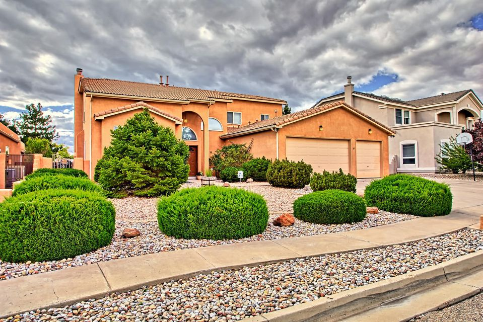 Custom multi-generational home in the desirable Estates at High Resort in Rio Rancho.  Original design includes a guest/in-law quarters with a full kitchen, BD, BA & sitting/dining area on main level. Five more bedrooms are upstairs.  The main kitchen features stainless steel appliances, granite composite counter tops, an island, breakfast nook and a pantry.Ceiling fans & pocket doors too.  Enjoy the mountain view from the deck off the master bedroom.  On the covered patio, the outdoor built-in BBQ will be a great place to entertain your guests near a soothing water feature.  The RV  pad is gated  & long enough to hold an RV, a boat & trailer.  The above ground pool will be refreshing on a hot summer day.  Seller will remove pool if desired. Guest quarters are not separate dwelling.