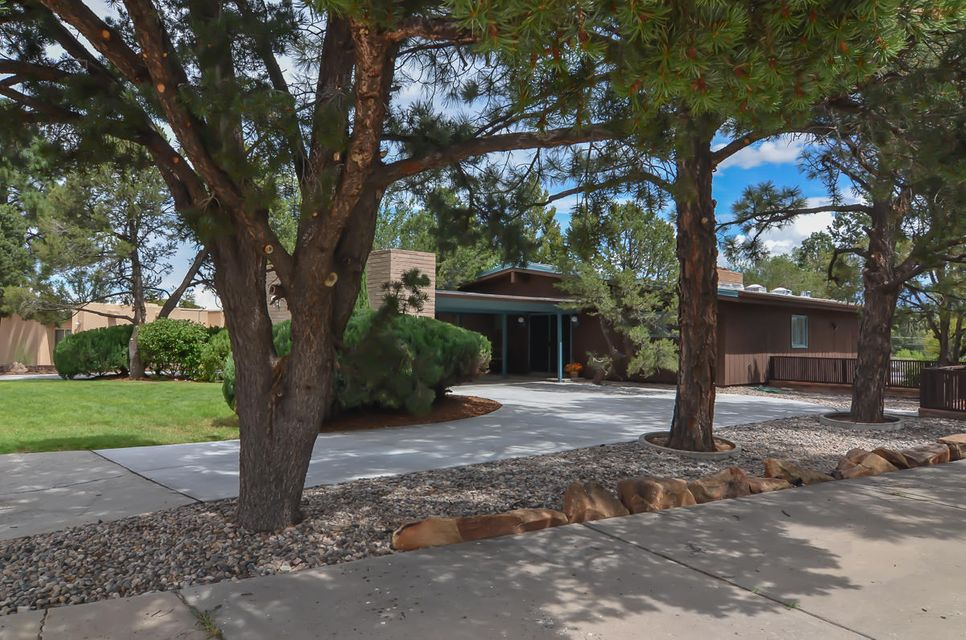 Breath taking Mid Century Max Flatow home in desirable North Campus Neighborhood. Amazing Great room with wall of windows bringing the outside in! Enjoy mountain views, lush greenery of trees and expansive patios. Vaulted ceiling and walls of wood are truly impressive and unique. This is an entertainers dream and art lovers delight. Dining room and well appointed kitchen both open to private patios that are plentiful and wonderful.  Enjoy the waterfall, views, grill and firepit  or frolic in the pool.  There is something for everyone. Master with sitting area and fireplace.  Office with walls of book cases. The family room and game room open to patio and pool. Bedrooms offer flexible options.  Great storage. New TPO roof with added insulation.A Stunning AUTHENTIC Mid Century Home!