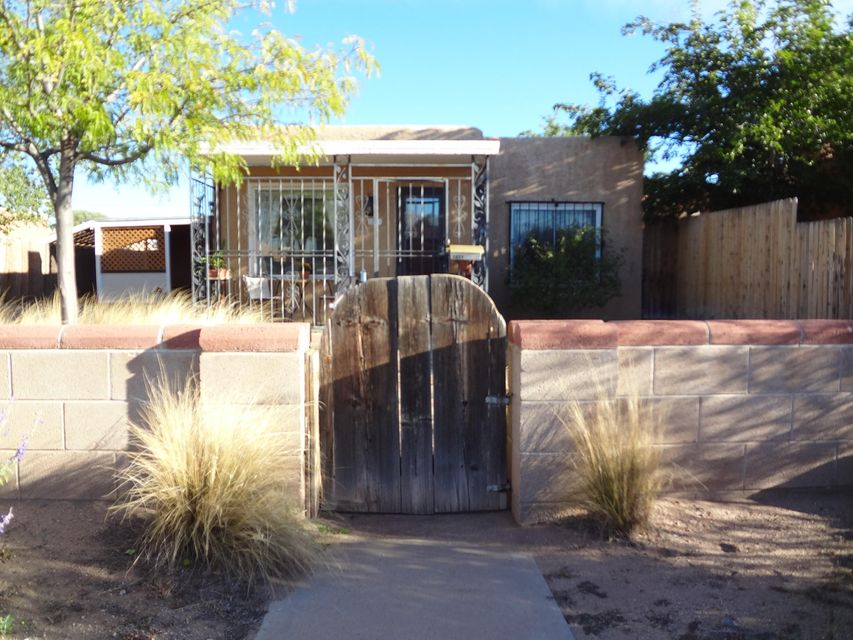 Charming home with large back yard located in the North Valley.  Very convenient - close to schools, grocery store, eateries and transit.  Home can be used as a single family home with in-law quarters, and 2-living areas or as investment property with two connected rental units.  First unit has living area, 1 bedroom, kitchen and full bathroom.  Second unit consists of living area, 2 large bedrooms with walk-in closets, kitchen and full bath with separate tub and shower.  All appliances including refrigerators, washer and dryer and window coverings stay.  READY FOR MOVE IN! For more information contact listing broker.