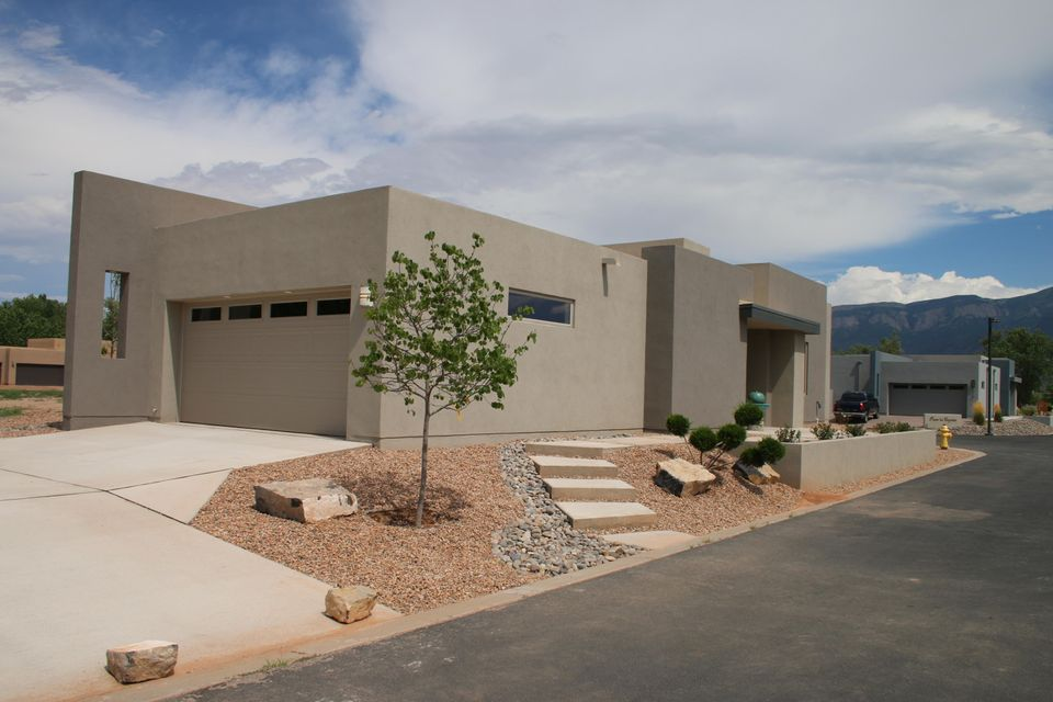 Active under contract - 48 hour right of first refusal. Newly Completed! Gorgeously upgraded, Contemporary style, an Abiquiu floor plan in the quiet, beautiful, gated subdivision of Bosque del Rio Grande. Access to the Bosque, and partial Bosque and Sandia Mountain views! 3 Bed, 1.75 Bath open floor plan features the following upgrades: sliding barn door to 3rd BR/Study, contemporary gas log FP, SS appliances (micro-hood, gas range, dishwasher), tile everywhere except carpeted bedrooms, granite counter tops, deco tile backsplashes, landscaped front. Backyard w/stucco wall (not landscaped). Separate Owners' Suite w/huge WI closet, double vanity, WI shower. Taexx Integrated Pest Control, auto front bubbler, grinder pump.
