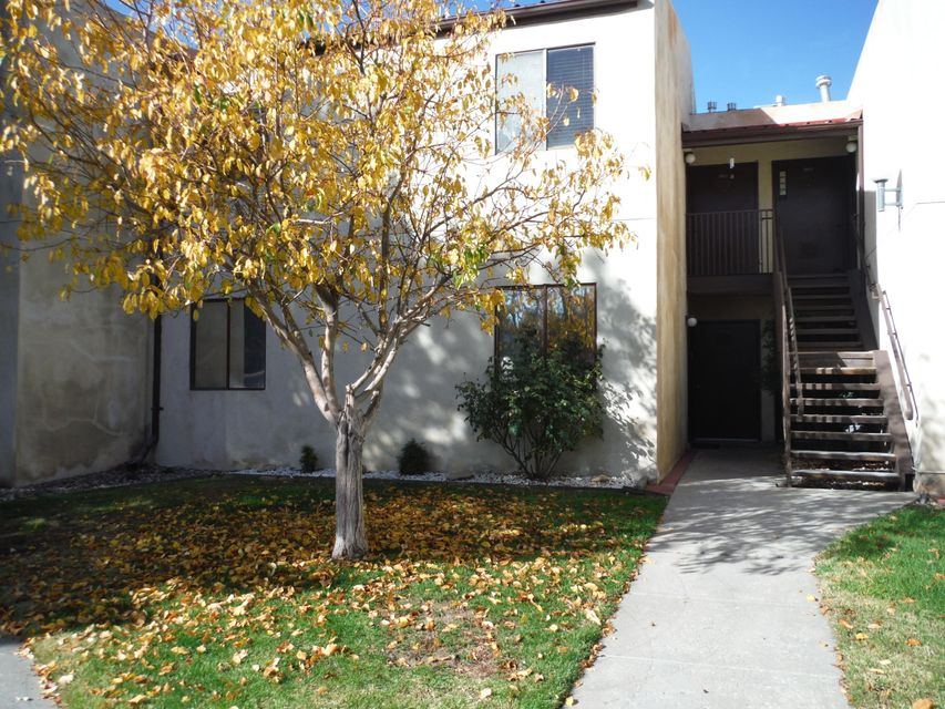 Large 2 bedroom condo in the Fairways Condominium Community in Rio Rancho. Ground floor unit, 1050 sq ft, New stove and dishwasher. All appliances stay including stacked washer and dryer.  Ceramic tile floors throughout.  Freshly Painted. Walk-in closet in master. Lots of storage. Glassed in Patio/Sunroom. Refrigerated Air. HOA maintains green space common areas, community pool and exterior of building. The condo is part of an estate and is being sold ''As Is''.