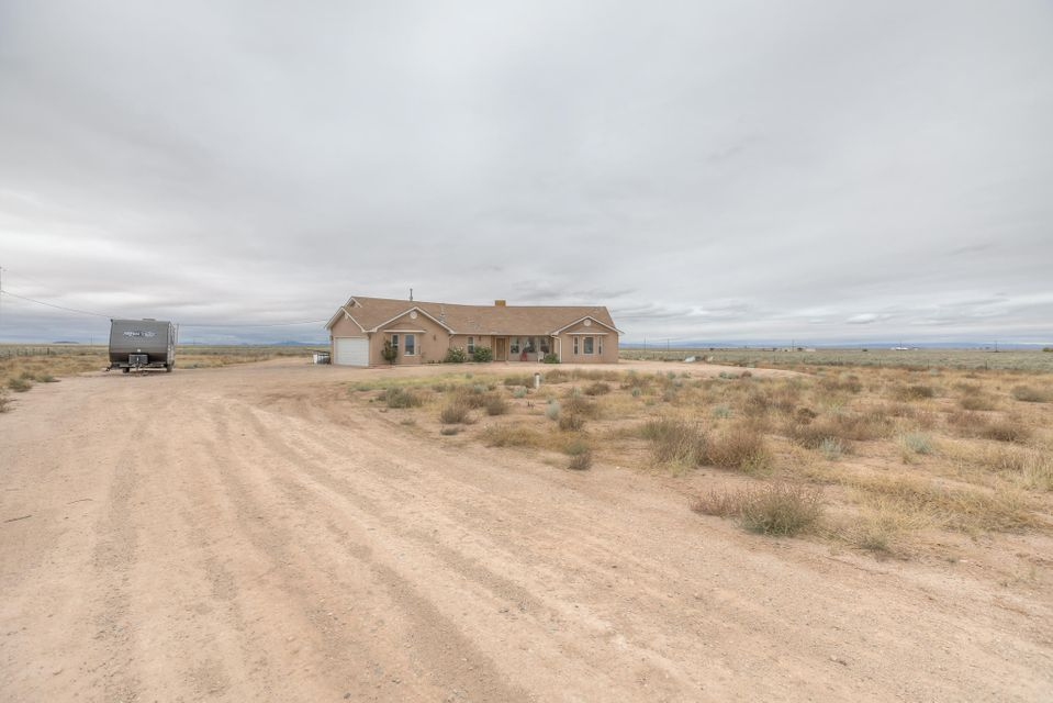 This home sits on 5 acres in beautiful Tierra Grande! Unobstructed views of the Manzano Mountains! This home was meticulously cared for. 3 bedroom, 2 1/2 bath with possible office /4th bedroom. Beautifully raised ceilings, covered patios and 2 car garage. Master bath has jetted tub, jack and jill sinks and gorgeous walk-in closet. Fabulous open kitchen with island, dining and large breakfast nook. On well and septic. This home won't last long! Seller requires 24 hour notice for showings. Schedule in ShowingTime.