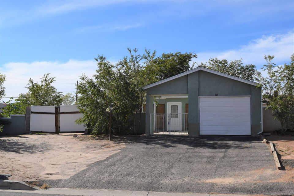 This home is so great with a large corner lot, back yard access and lots of natural light inside plus 2 living areas. Upgraded with ceramic tile in nearly every room. This floorplan is wide open. Three bedrooms, 2 full baths and a walkin closet in the large master and an office area up front. There is a fireplace for those cool nights in the second living area. Come and take a look! The back yard has fruit trees and a storage shed that comes with the property.  Come see!!