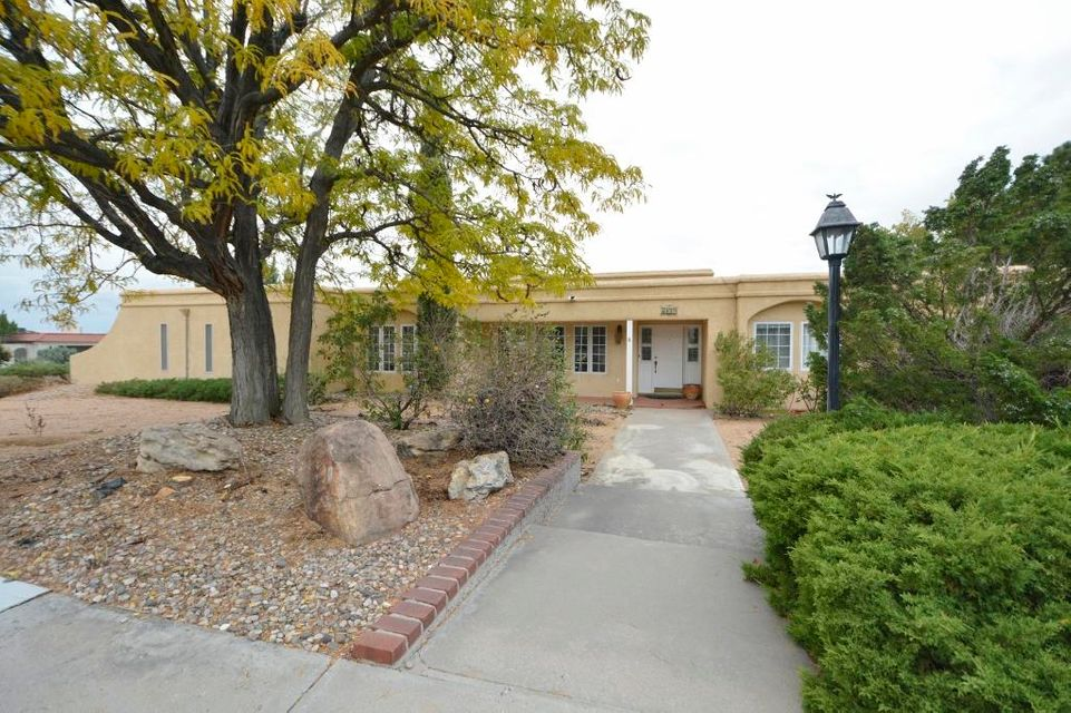 Oversized .46 Acre Corner Lot! BACKYARD ACCESS! Incredible backyard for entertaining family & friends with the great room & game room opening on to the covered patio, pool area and beautiful landscaping!  Separate wings, 4BDRs, 3BATHs, TWO living areas, formal dining and large game room with built-ins, cabinets & wet bar!  Refrigerated Air!  Pool & electric pool cover!  Lots of windows and skylights make it light, bright and open!  Kitchen features a built-in oven, gas cooktop, built-in cabs, tile flooring & bkfst nook.  Oversized master suite opens on to the covered patio & features a jetted tub, separate shower, double vanity and walk-in closet.  Close to Four Hills Golf Course & Country Club, shopping, easy access to KAFB, Sandia Labs, downtown ABQ!!