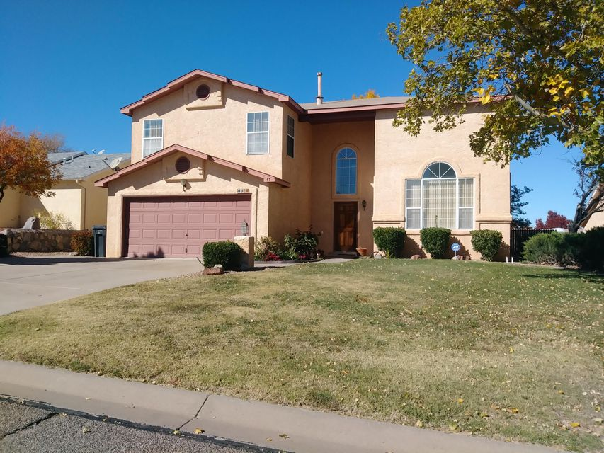 Spacious three bedroom home. Great views Large back yard with Covered patio. Fully landscaped with storage shed Open kitchen  with breakfast nook and bar.All appliances stay. Two living room. Family room has fireplace. Separate dining area. Great for entertaining. Close to park and shopping centers. Ready for a new buyer today.