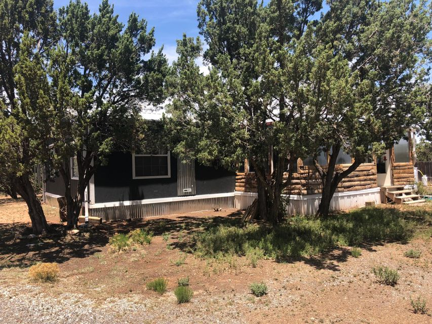 This well kept 2 bedroom home sits on it own private 1 acre lot in the country. It features a covered 4 car carport, and a well maintained lot ready for you to make a mountain sanctuary. Close to the stores in Edgewood, and only about 30 minutes form Albuquerque!