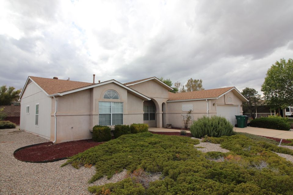 Almost perfect is one way to describe this updated home that is within walking distance to the bosque.  A much sought after location minutes from shopping, the town of Bernalillo, and miles and miles of river trails.  A new roof was installed in 2018 making this home a great value for years to come. 3 bedrooms, 2 bathrooms, 2 living rooms, and a 2 car oversized garage make this home spacious and livable for any of your needs. The natural lighting and sky lights in the home will welcome you as you walk in the entry way. You'll love the kitchen that opens up to the breakfast nook and 2nd living room. Master bath is large with double closets and vaulted ceilings in the suite. The yard is landscaped, water efficient, and low maintenance. You'll also love the workshop area in the garage!