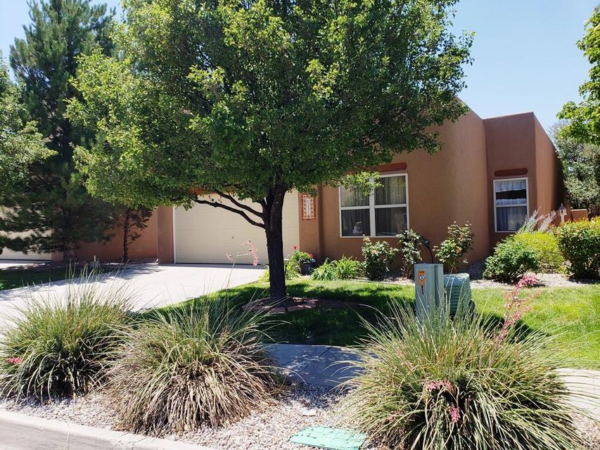 Amazing Hidden Valley home that backs to walking trail and open space. 3 bedrooms plus an office/4th bed with a closet. Open floor plan with Kiva gas fireplace. Roof has been maintained, New stucco work has been done and gutters cleaned. Seller maintains it well.  Remodeled Master bath floor, vanity, and fixtures. New paint in the bedrooms. Large tiles in most of the house except bedrooms. Beautiful backyard with coveredporch and a fountain and lots of greenery. Front yard has gorgeous roses and lush grass. Washer/dryer/refrigerator negotiable. Finished 2 car garage with shelvingand peg board. hot tub does convey. Community has a pool, club house, and pond. Beautiful area.