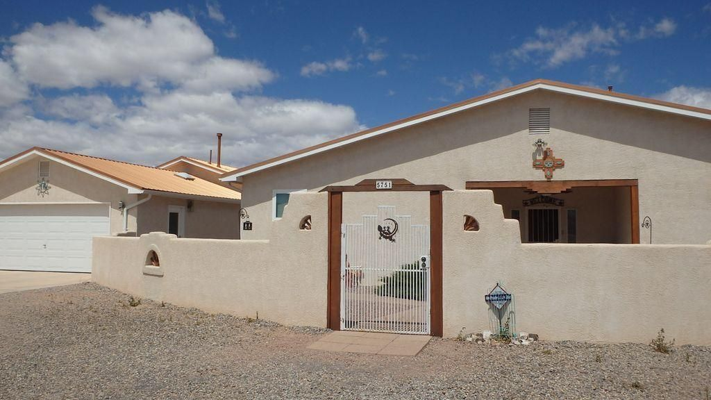 4 bedroom horse property w/1500sf heated/cooled workshop and 4 car garage, barn w/RV storage & hookup and electric powered rear gate. The main home has natural sunlight w/7 skylights, refrigerated air, irrigation well & city water, gas kiva fireplace, newer windows and glass block accents. Kitchen has gas stove, pantry, solid surface counters and stainless appliances. Remodeled master bath w/jetted tub. Mountain views from all 3 patios. Workshop is equipped w/200 amp service and compressor hookups, 2X6 construction & half bath. Additional storage buildings & stalls for equipment/horses that is completely fenced, round pen & x fenced. All trees & vegetation on auto-drip. New 50 gal water heater (2018) & metal roof (2017). The property has been meticulously maintained and shows beautifully!