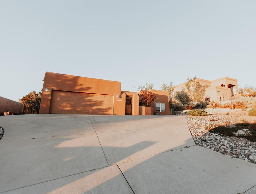 Beautiful southwest appeal home. Four bedrooms with vigas, ceiling beams and adobe accent. No carpet, just tile and wood laminate. Spacious living area. Kitchen has stainless steel appliances, formal dining area. Lovely mountain views from the court yard and much more.