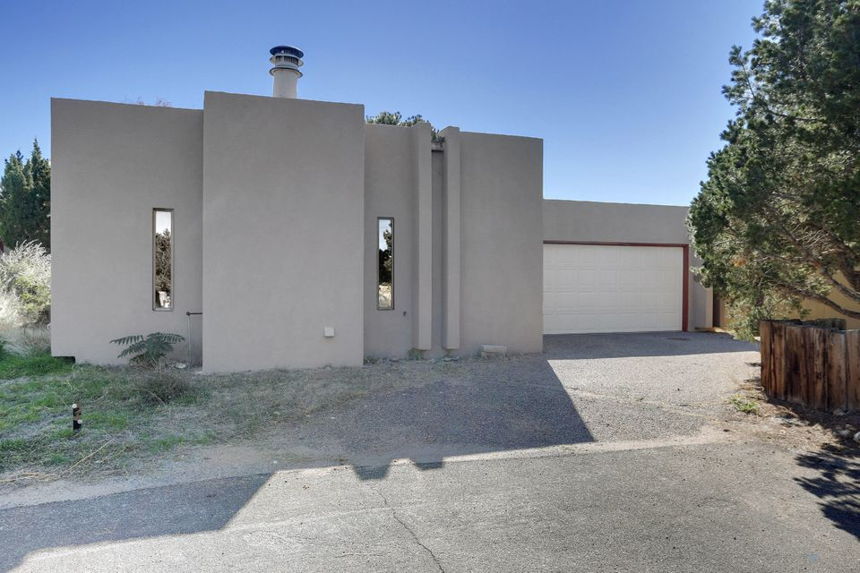 Exclusive Sandia Heights with mountain views! New stucco and flooring.  New-ish roof, and appliances.