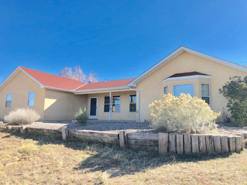 Huge Price Reduction!! Right in the Heart of Edgewood.  Great Views, Close to Shopping and Albuquerque Access.  Completely fenced for critters.  Home has two living area, cozy fireplace. New Carpet! Open style Kitchen with lots of storage. Oversized attached garage.  Covered patio.