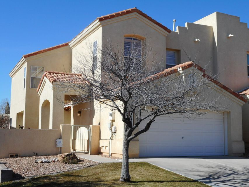 Quietly situated in a GATED COMMUNITY sits this exceptional Townhome  offering! Gracious courtyard entry welcomes you into the fully ceramic tiled lower level with open kitchen and Great room concept. Generous informal dining room. Convenient powder room downstairs for guests. Massive kitchen island, pantry, gas range and lots of cabinets! Cozy gas-log  fireplace and built-ins in the living space. Separate laundry room with cabinets and folding area. The MasterSuite boasts mountain views, ceiling fan and a spacious walk-in closet!  The private Master Bathroom with dual vanities, garden tub and separate shower is sure to please! Built-in bookshelves,ceiling fans, skylight & glass block accents! 2 more bedrooms upstairs with ample closet space and a second full bath! Fully lansdcaped!