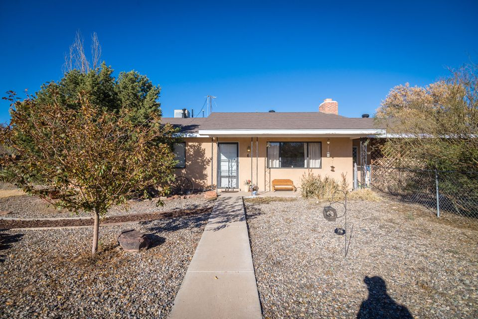 This charming home is ready for a new owner!  This home sits on .50 acres and features 2 living areas, 4 bedrooms (possible 5th), beautiful wood burning fireplace and built-in bookshelves.  New roof (2016) and updated septic (2017).  The kitchen has tons of cabinet space and has been updated with Corian countertops!  Heated/cooled bonus room can be used as a hobby shop, game room, in-law quarters or study.  There's a large mudroom inside the back door with plenty of room for storage! The backyard is fully fenced and complete with a 2.5 stall barn and chicken coop. This home has plenty of room, come take a look today!