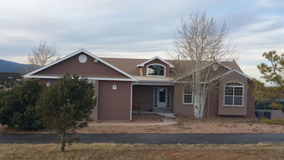 A great home with 3,249 sq. ft. and so many amenities! Main level has 2 bdrms, 2 baths, 1 office and a gas fireplace.  A fully appointed walk out basement with large family room, gas fireplace, 3 bdrms & 1 baths. 3 car garage + a 30'X40' RV/workshop with wood stove. Such a beautiful home with amazing views, as a former Parade home it has many custom Builder upgrades, amazing kitchen with a spacious custom baking center, Halbert custom cabinets, pantry, built in vacuum system. Brand new carpet and freshly painted. There is a play area for the family dogs with shade!