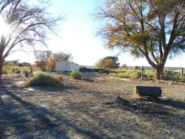 Privately tucked away 16x80 3 bedroom 2 bath home on 2.7 acres for only $68,000Easy freeway access.