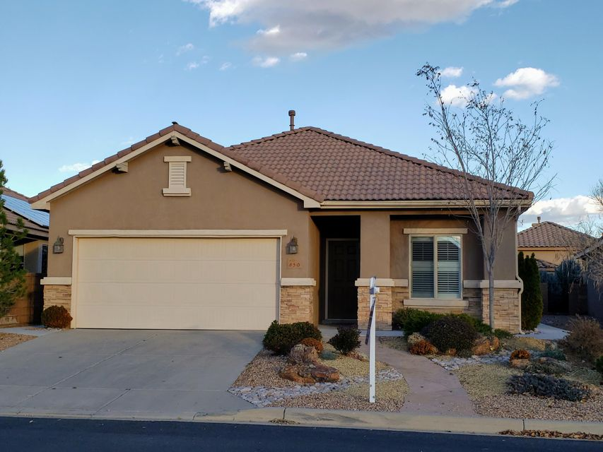 Cheerful home with an abundance of natural light.  Located in NM's premier 55+ active adult community by Del Webb.  Ideal open floor plan with two bedrooms plus large den/optional 3rd bedroom.  Well designed kitchen with stainless steel appliances, gas cooktop, double oven, built in microwave and walk-in pantry.  All appliances are included for your convenience.  Gorgeous wood floors in all main living areas.  Tile in all wet areas.  Absolutely NO carpet.  Ceiling fans throughout.  Skip trowel finished walls.  Wired for alarm.    Backyard retreat with patio which extends all the way around the home.  Sidewalks lead from the back to the front of the home.  Mature landscaping and water fountain.  Convenient location just steps from the clubhouse and all community amenities.  Welcome home