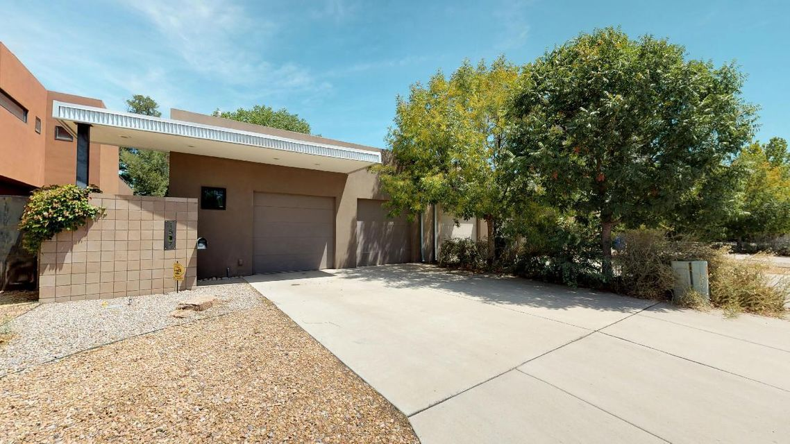 Gorgeous Modern Country Club area home! Space abounds in the open home w/ floor to ceiling windows and indoor-outdoor living space! Granite counter-tops, high ceilings, refrigerated air! 3 LARGE bedrooms with theater room and office area! Master bedroom is located downstairs with large walk-in closet and direct access to the private back patio! Close to Downtown, Albuquerque Country Club, Kit Carson Park and much more!